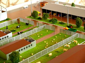 The central flowerbed on the farm layout shows trees and bushes